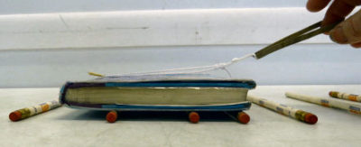 rollers under book