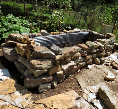 stone walls of raised garden bed